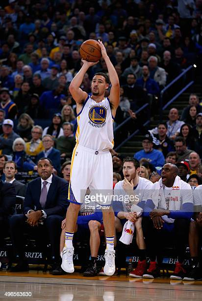 Klay Thompson of the Golden State Warriors shoots the ball against the Detroit Pistons at ORACLE Arena on November 9 2015 in Oakland California NOTE...