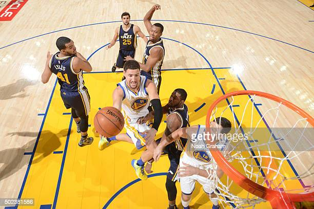 Klay Thompson of the Golden State Warriors shoots the ball against the Golden State Warriors on December 13 2015 at ORACLE Arena in Oakland...