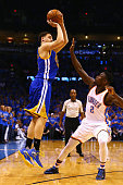 Klay Thompson of the Golden State Warriors shoots the ball against Anthony Morrow of the Oklahoma City Thunder during the second half in game six of...