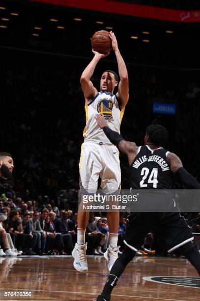 Klay Thompson of the Golden State Warriors shoots the ball against the Brooklyn Nets on November 19 2017 at Barclays Center in Brooklyn New York NOTE...