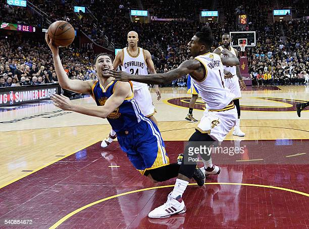 Klay Thompson of the Golden State Warriors shoots the ball as he falls during the second half against the Cleveland Cavaliers in Game 6 of the 2016...