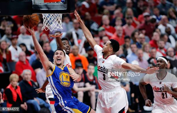 Klay Thompson of the Golden State Warriors shoots the ball over Al Farouq Aminu of the Portland Trail Blazers during Game Three of the Western...