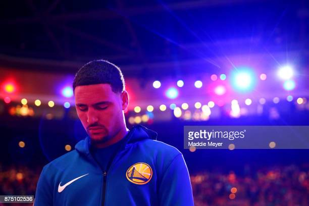 Klay Thompson of the Golden State Warriors stands for the national anthem before the game against the Boston Celtics at TD Garden on November 16 2017...