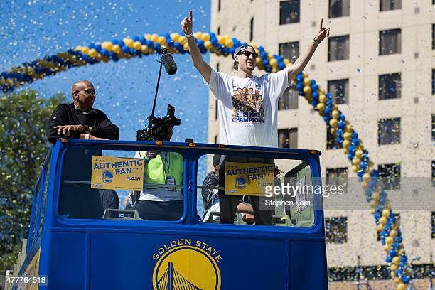 Klay Thompson of the Golden State Warriors surveys the crowd during the Golden State Warriors Victory Parade in Oakland California Thousands are...