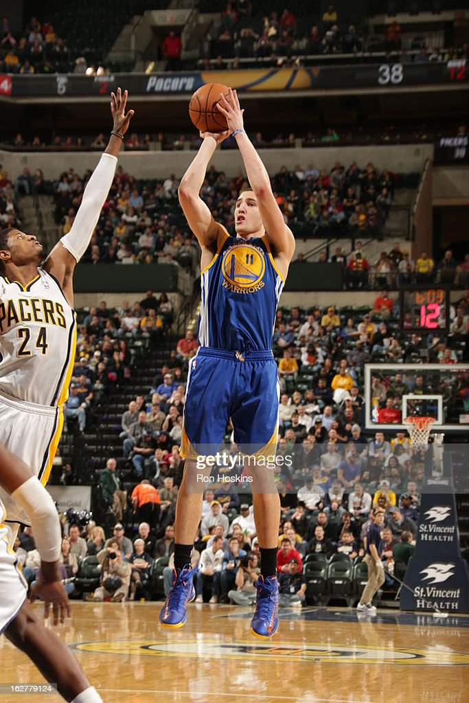 Klay Thompson #11 of the Golden State Warriors takes a shot against the Indiana Pacers on February 26, 2013 at Bankers Life Fieldhouse in Indianapolis, Indiana.