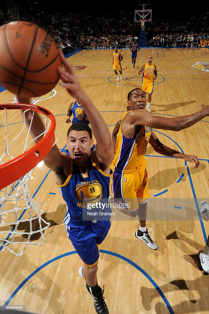 <a gi-track='captionPersonalityLinkClicked' href=/galleries/search?phrase=Klay+Thompson&family=editorial&specificpeople=5132325 ng-click='$event.stopPropagation()'>Klay Thompson</a> #11 of the Golden State Warriors throws down the dunk against <a gi-track='captionPersonalityLinkClicked' href=/galleries/search?phrase=Wesley+Johnson+-+Basketball+Player&family=editorial&specificpeople=4184049 ng-click='$event.stopPropagation()'>Wesley Johnson</a> #11 of the Los Angeles Lakers at Citizens Business Bank Arena on October 5, 2013 in Ontario, California.