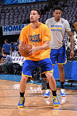 Klay Thompson of the Golden State Warriors warms up before Game Four of the Western Conference Finals against the Oklahoma City Thunder during the...