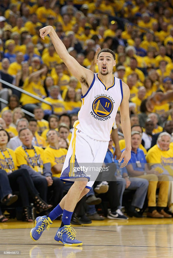 Klay Thompson #11 of the Golden State Warriors watches a three-point basket go in against the Portland Trail Blazers during Game One of the Western Conference Semifinals for the 2016 NBA Playoffs at ORACLE Arena on May 01, 2016 in Oakland, California.
