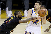 Klay Thompson of the Golden State Warriors with the ball against Kyrie Irving of the Cleveland Cavaliers in the first half in Game 5 of the 2016 NBA...