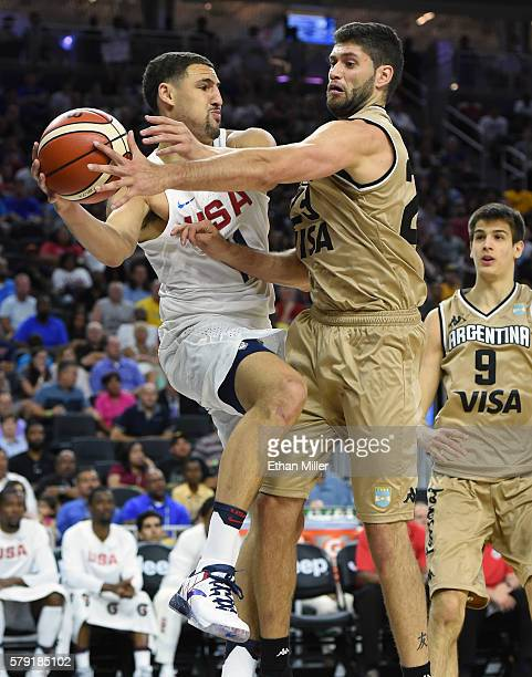 Klay Thompson of the United States tries to pass from the baseline as he is fouled by Patricio Garino of Argentina during a USA Basketball showcase...