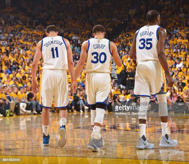 Klay Thompson Stephen Curry and Kevin Durant of the Golden State Warriors walk up the court in Game One of the Western Conference Finals against the...