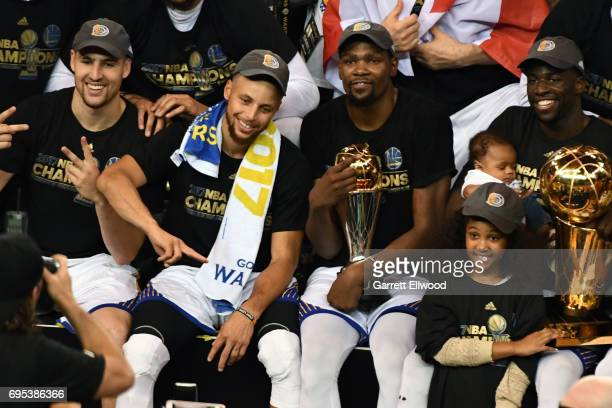 Klay Thompson Stephen Curry Kevin Durant and Draymond Green of the Golden State Warriors pose for a team photo after winning the NBA Championship and...