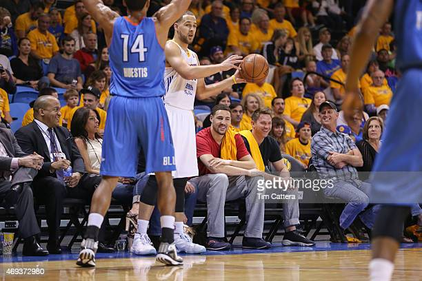 Klay Thompson watches his brother Mychel Thompson of the Santa Cruz Warriors inbound the ball against the Oklahoma City Blue during the Western...