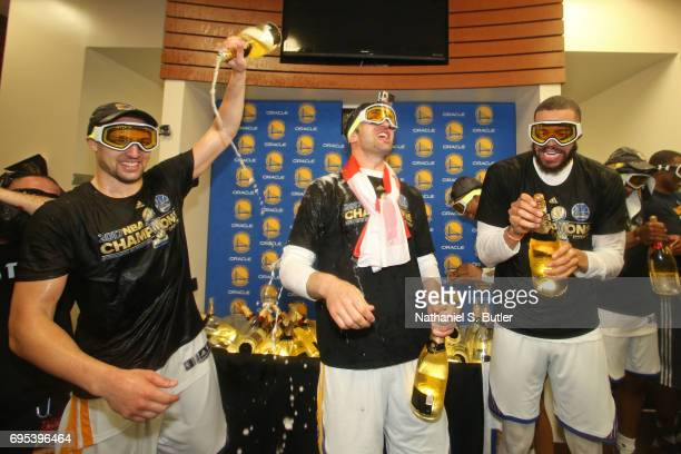 Klay Thompson Zaza Pachulia and JaVale McGee of the Golden State Warriors celebrate in the locker room after winning the NBA Championsip in Game Five...