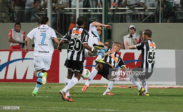 Kleber of Gremio fights for the ball with Richarlison and Pierre of Atletico during a match between Atletico MG and Gremio as part of the brazilian...