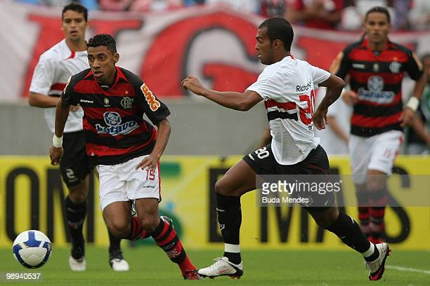 Kleberson of Flamengo fights for the ball with Richarlison of Sao Paulo during a match as part of the Brazilian Championship at Maracana Stadium on...