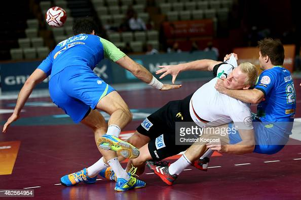 Kleem Cehte of Slovenia and Marko Bezjak of Slovenia defend against Patrick Wiencek of Germany during the eighth place match between Germany and...
