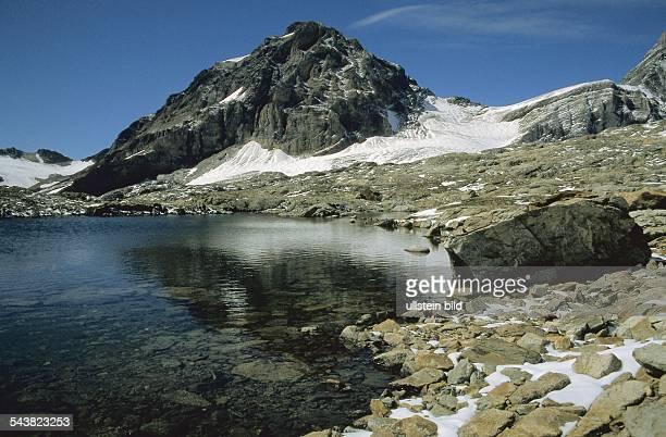 Kleiner Bergsee vor dem Ferdenrothorn am Lötschenpass Unter diesem Gebiet verläuft der Lötschentunnel ein 17 km langer Eisenbahntunnel Undatiertes...
