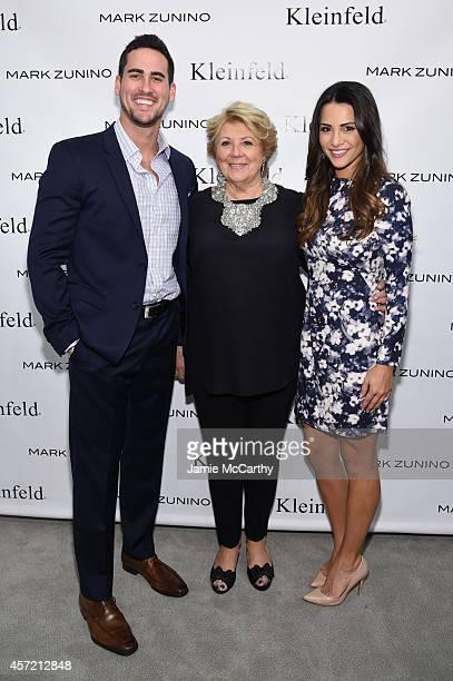 Kleinfeld coowner Mara Urshel poses with Television personalities Josh Murray and Andi Dorfman at The Mark Zunino For Kleinfeld 2015 Runway Show at...