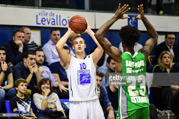 Klemen Prepelic of Levallois and Howard Sant Roos of Darussafaka Dogus Istabul during the EuropCup match between Levallois Metropolitans and...