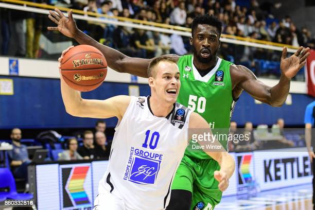 Klemen Prepelic of Levallois and Michael Eric of Darussafaka Dogus Istabul during the EuropCup match between Levallois Metropolitans and Darussafaka...