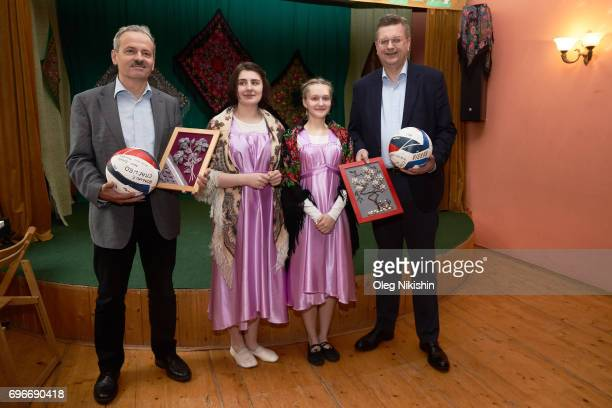 Klemes Buscher and DFB President Reinhard Grindelduring their visit at The Don Bosco Children's Home on June 16 2017 in Moscow Russia