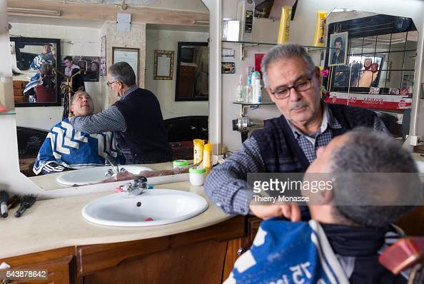 Kélibia Nabeul Governorate Tunisia January 10 2015 A barber shave a man in his shop