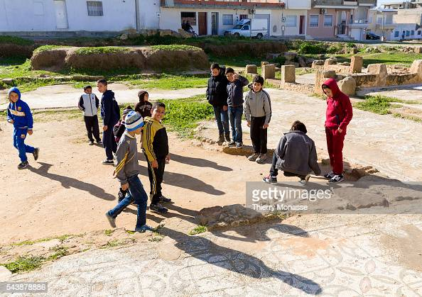 Kélibia Nabeul Governorate Tunisia January 10 2015 Childs are playiong on Roman mosaic