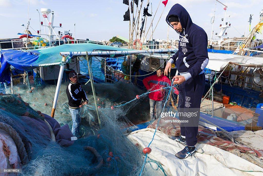 Kélibia Nabeul Governorate Tunisia January 10 2015 Fishermen repairs their net