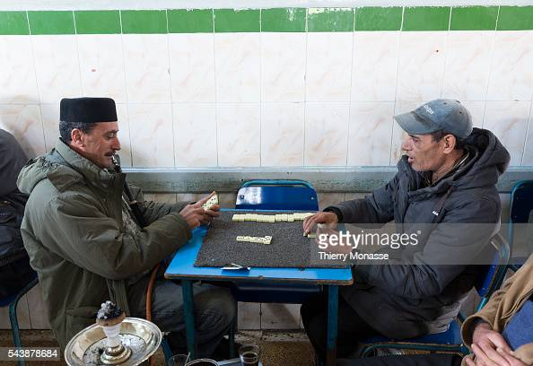 Kélibia Nabeul Governorate Tunisia January 10 2015 Men are playing with Dominoes in a cafe