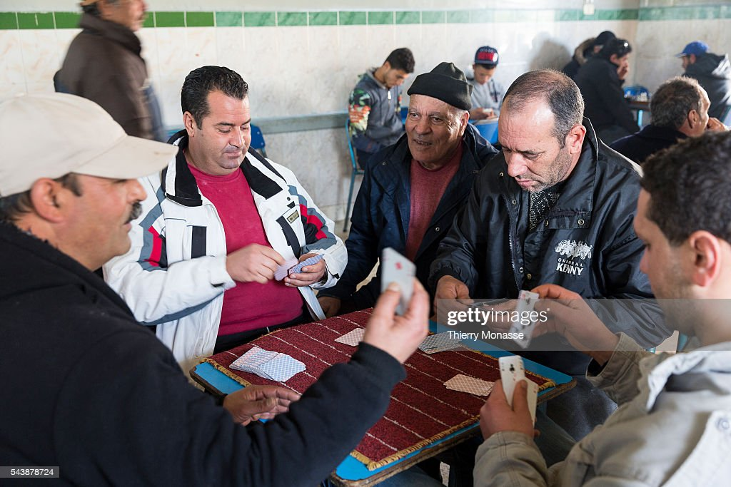 Kélibia Nabeul Governorate Tunisia January 10 2015 Men are playong a card game in a cafe
