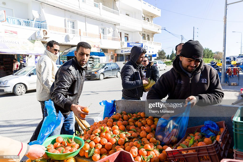 Kélibia Nabeul Governorate Tunisia January 10 2015 Men are saling oranges in the street of Kelibia