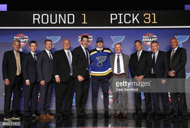 Klim Kostin poses with team personnel onstage after being selected 31st overall by the St Louis Blues during Round One of the 2017 NHL Draft at...
