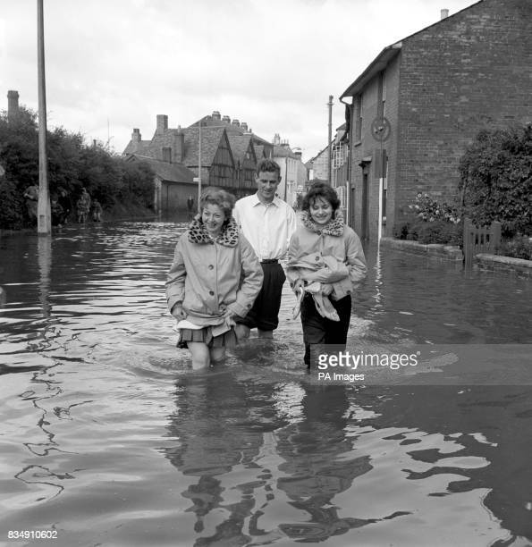 Knee deep in water people wade through the floods in Romsey Hampshire The small town had its worst flooding for seventy years with water eight feet...