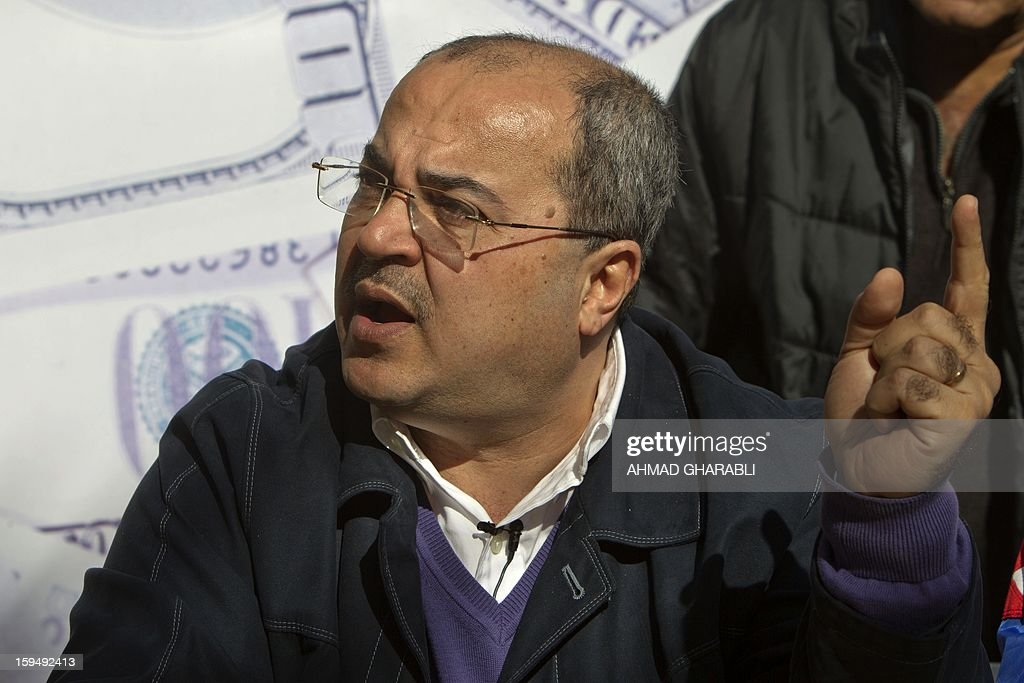 Knesset (parliament) member Israeli Arab Ahmad Tibi campaigns seeking reelection ahead of Israel's general elections in the Israeli Arab town of Umm al-Fahm on January 14, 2013. Arab-Israelis, descendants of the 160,000 Palestinians who stayed on after the creation of Israel in 1948, make up 20 percent of the population.