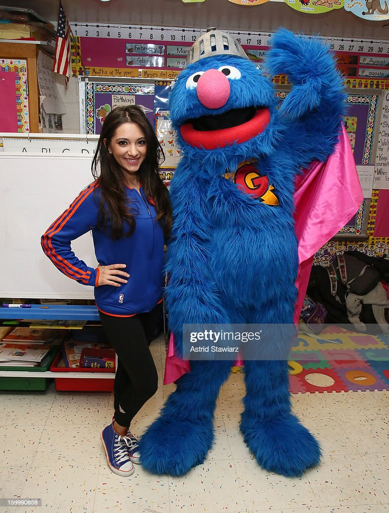 Knicks City Dancer Dominique and Sesame Street Live's Super Grover teach children from WHEDCo how to be super heroes on January 24, 2013 in New York City.