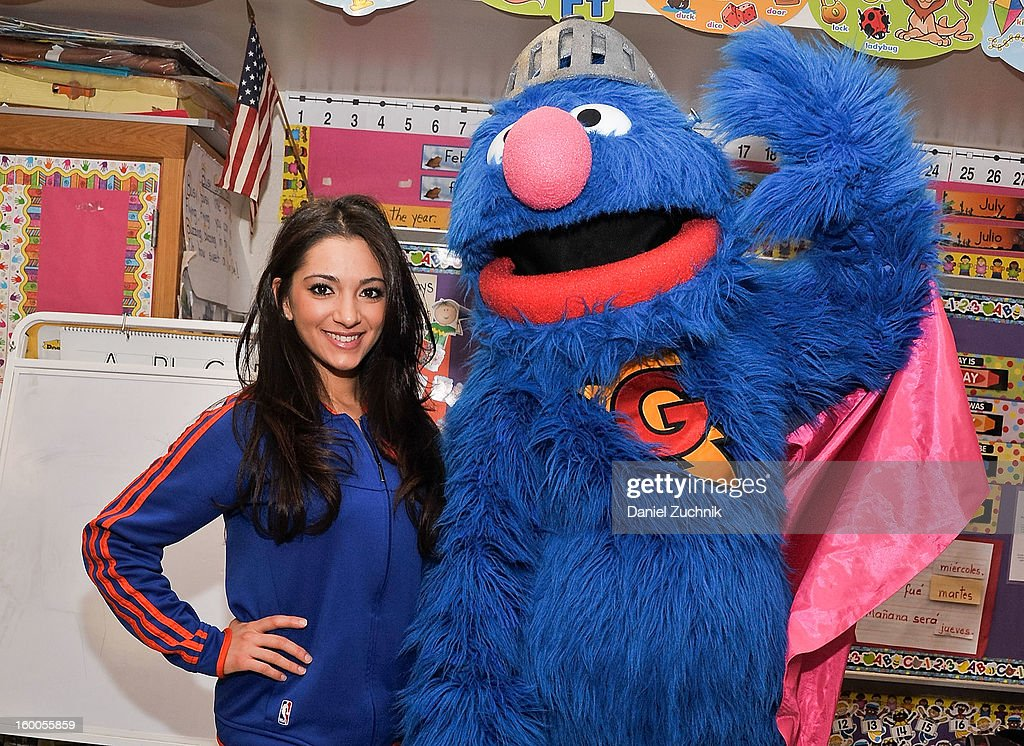Knicks dancer Dominique and Super Grover teach kids to be a super hero at the WHEDCo classroom on January 24, 2013 in New York City.