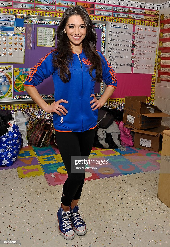 Knicks dancer Dominique teaches kids to be a super hero at the WHEDCo classroom on January 24, 2013 in New York City.