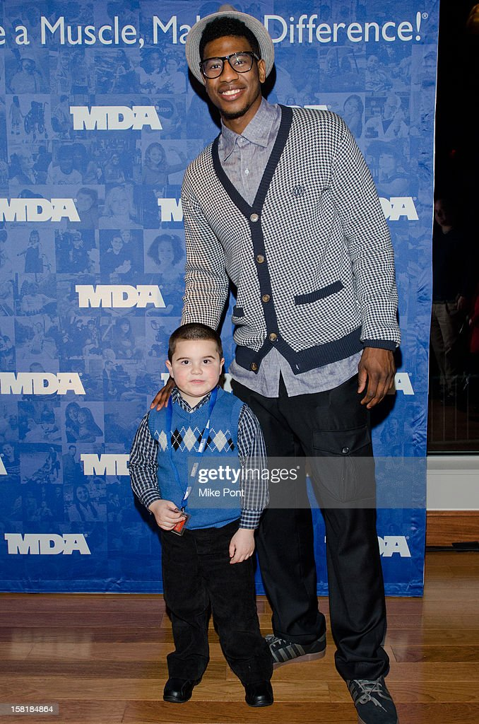 NY Knicks Iman Shumpert (R) attends MDA's 2013 Muscle Team Kick Off Event at The Lighthouse at Chelsea Piers on December 10, 2012 in New York City.