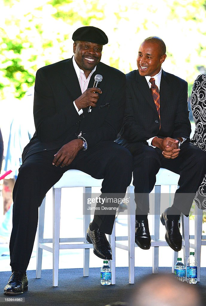 NY Knicks Legends <a gi-track='captionPersonalityLinkClicked' href=/galleries/search?phrase=Patrick+Ewing&family=editorial&specificpeople=202881 ng-click='$event.stopPropagation()'>Patrick Ewing</a> and <a gi-track='captionPersonalityLinkClicked' href=/galleries/search?phrase=John+Starks&family=editorial&specificpeople=211118 ng-click='$event.stopPropagation()'>John Starks</a> attend Madison Square Garden's 'Garden 366' And 'Defining Moments' Exhibition Openings at Madison Square Park on October 11, 2012 in New York City.