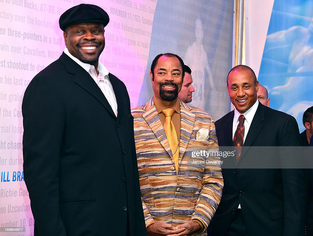 NY Knicks Legends <a gi-track='captionPersonalityLinkClicked' href=/galleries/search?phrase=Patrick+Ewing&family=editorial&specificpeople=202881 ng-click='$event.stopPropagation()'>Patrick Ewing</a>, <a gi-track='captionPersonalityLinkClicked' href=/galleries/search?phrase=Walt+Frazier&family=editorial&specificpeople=211195 ng-click='$event.stopPropagation()'>Walt Frazier</a> and <a gi-track='captionPersonalityLinkClicked' href=/galleries/search?phrase=John+Starks&family=editorial&specificpeople=211118 ng-click='$event.stopPropagation()'>John Starks</a> attend Madison Square Garden's 'Garden 366' And 'Defining Moments' Exhibition Openings at Madison Square Park on October 11, 2012 in New York City.