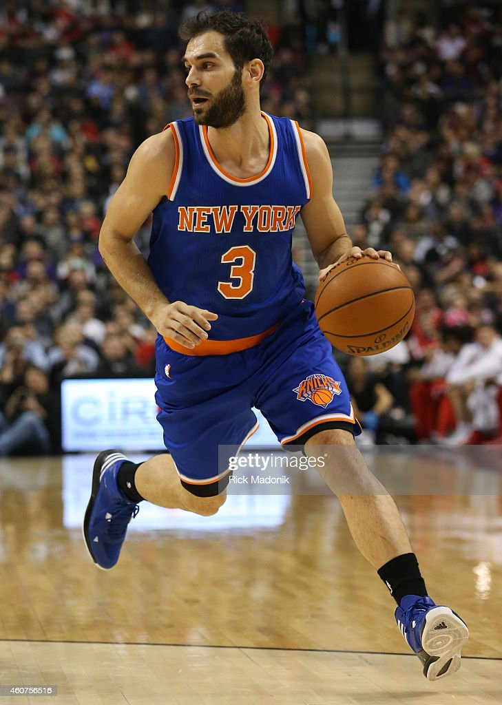 TORONTO - DECEMBER 21 - Knicks point guard Jose Calderon moves the ball up court. Toronto Raptors vs New York Knicks during 1st half action at the Air Canada Centre of the NBA season on December 21, 2014.