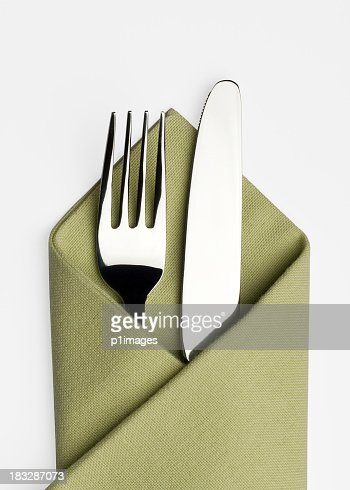 Knife and fork in a green napkin