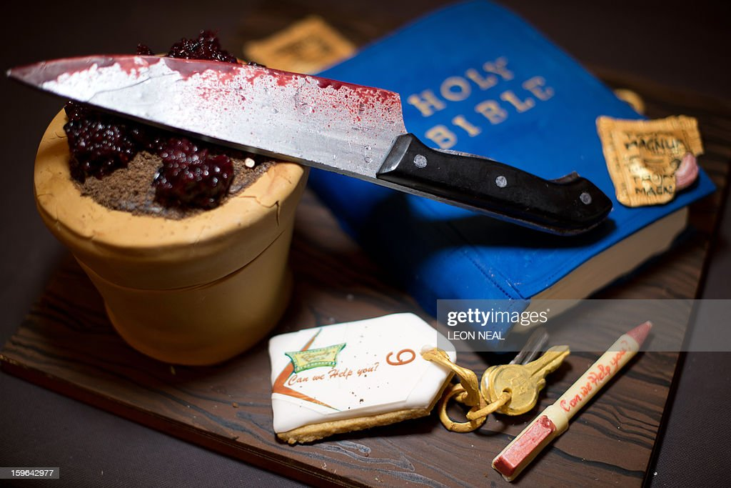 A knife, bible, keys and pen made from whisky, vine fruit and apricot cake are displayed at a film set pop-up experience in east London on January 17, 2013. The event was held to promote the release of a new horror film 'The Helpers'.
