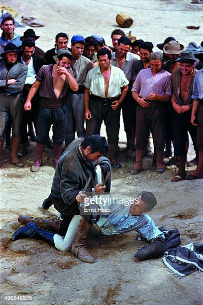 A knife fight between Cary Grant and José Nieto in a scene from the film 'The Pride and the Passion' 1956