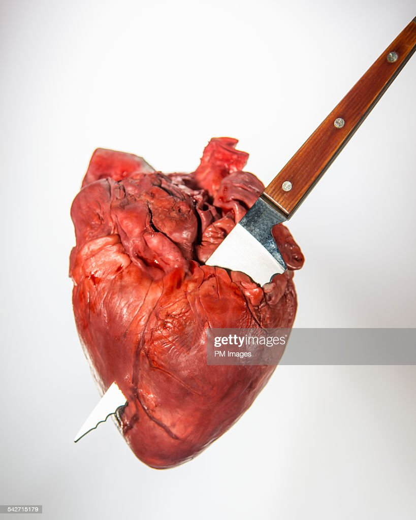 Realistic Knife In The Heart Drawing: Knife Through The Heart Stock Photo