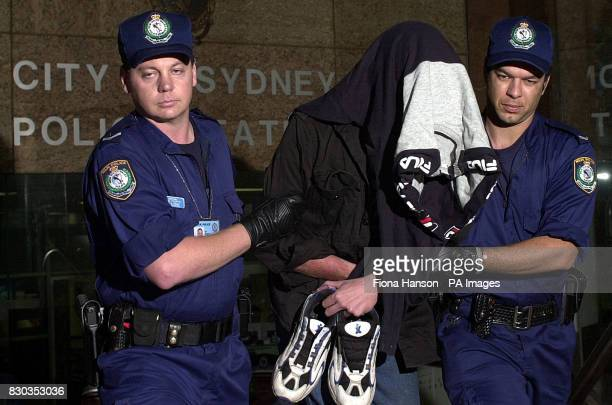 Knifeman Gregory Pailthope is led away from Sydney Central Police Station to appear before a Magistrate after he was arrested with a knife at Darling...