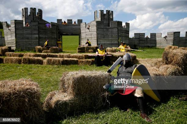 A knight takes a break between battles at Ragnarok XXXII on June 21 2017 For one week each summer the World has come to an end as over 1000 people...