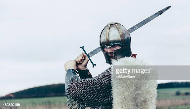 Knight with sword and helmet is about to attack