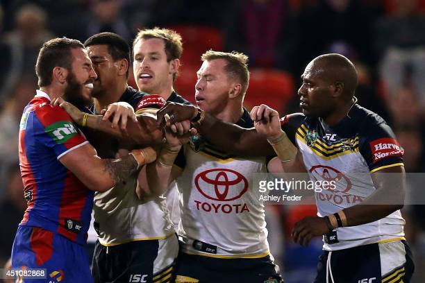 Knights and Cowboys players in an altercation during the round 15 NRL match between the Newcastle Knights and the North Queensland Cowboys at Hunter...